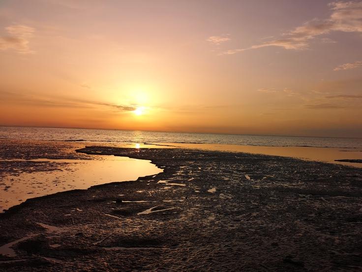 Solnedgång Neptuni åkrar
